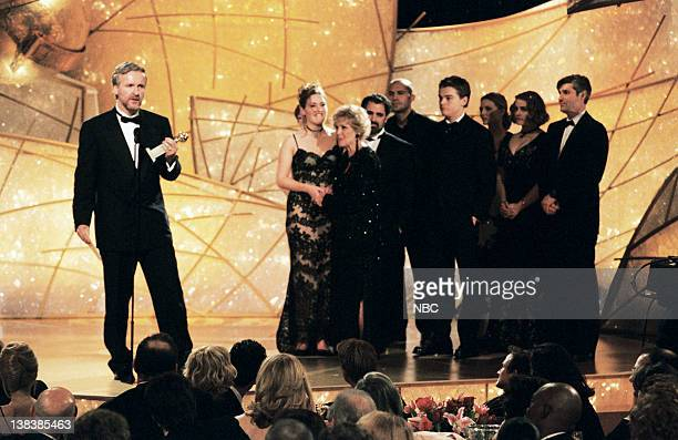 Golden Globe winner for best Picture Drama 'Titanic' James Cameron and the cast of the movie on stage during the 55th Annual Golden Globe Awards held...