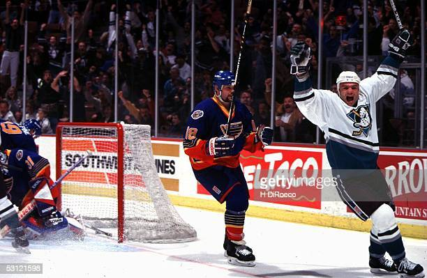 Brian Bellows of the Mighty Ducks of Anaheim celebrates after a goal against St Louis Blues goalie Grant Fuhr