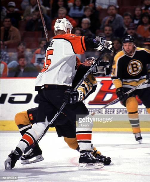 Chris Gratton of the Flyers levels Don Sweeney of Boston.