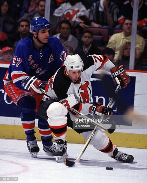 Dave Andreychuk of the Devils battles Kevin Stevens of the Rangers