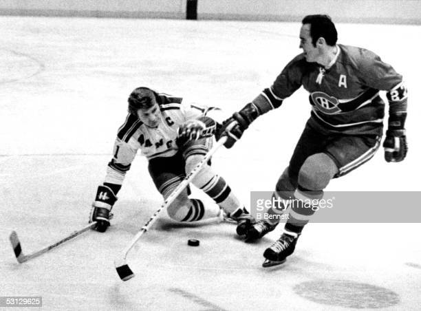 Frank Mahovlich battles with Vic Hadfield during the second period, 4-13-74.