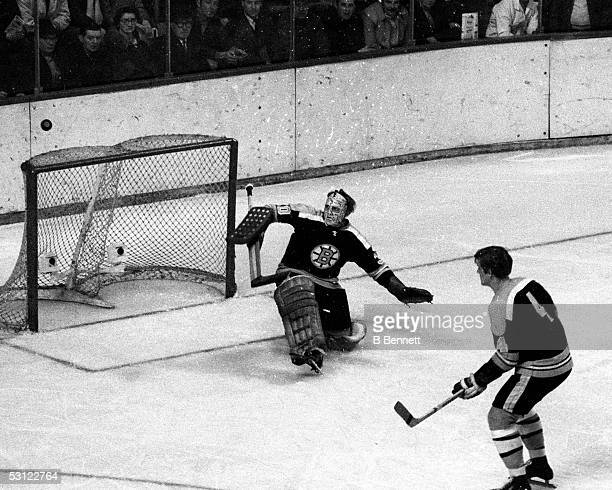 Gerry Cheevers makes a save as Bobby Orr looks on And Player Gerry Cheevers.