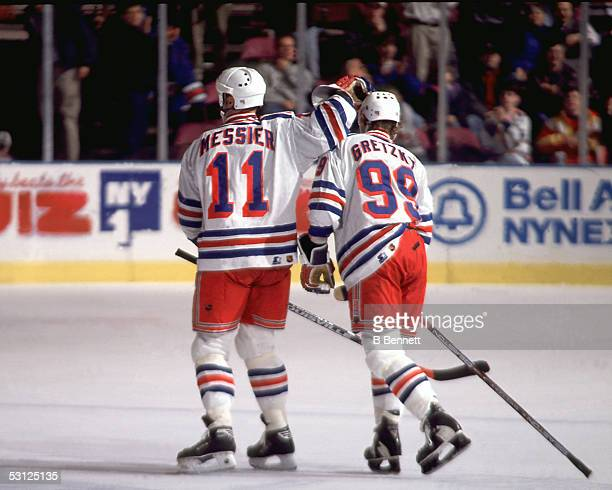 Gretzky and Messier celebrate And Player Wayne Gretzky