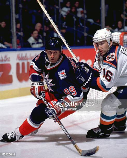 Gretzky battles with Zigmund Palffy of the Islanders