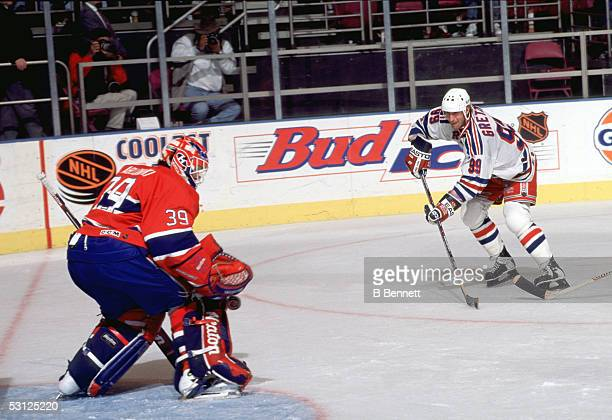 Gretzky moves in and fires a shot off of the pad of Canadien goaltender Pat Jablonski
