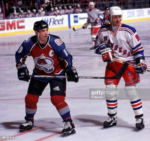 Joe Sakic of Colorado and Wayne Gretzky of the Rangers