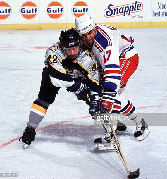 Joel Bouchard of the Nashville Predators battles with Kevin Stevens of the Rangers