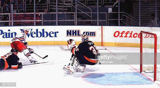 Kevin Stevens puts one past Islander goaltender Tommy Salo as Kenny Jonsson dives to stop the shot