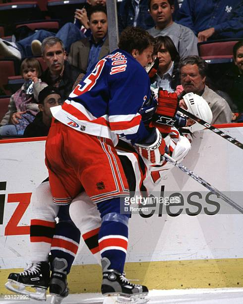 Kim Johnsson of the Rangers drops Randy McKay of the Devils