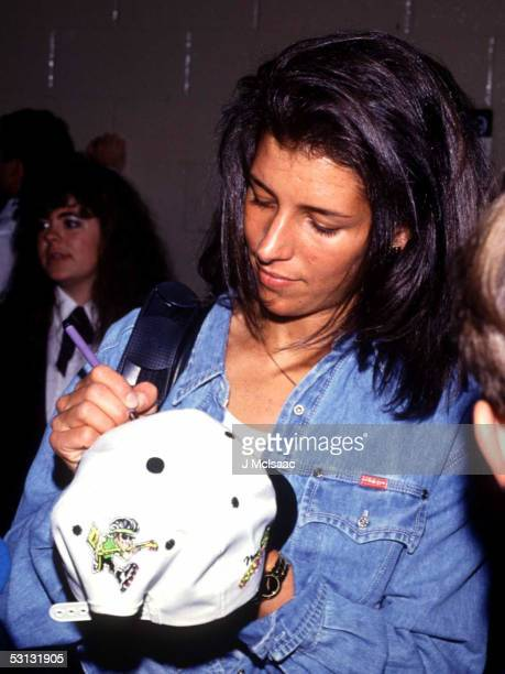 Manon Rheaume takes a minute to sign a fans hat before opening night of the New Jersey Rockin' Rollers roller hockey season