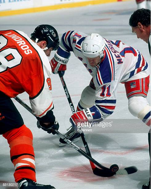 Mark Messier faces off against Eric Lindros of the Flyers