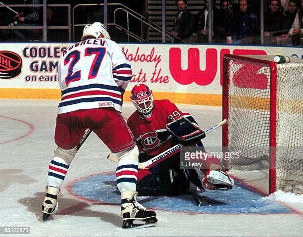 Montreal goaltender Pat Jablonski makes the kick save as Ranger Alexei Kovalev pursues the rebound