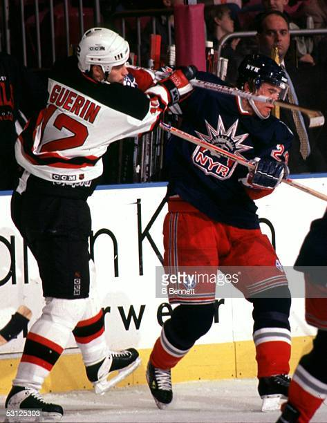 New Jersey Devil Bill Guerin gets his stick up on Niklas Sundstrom of the New York Rangers