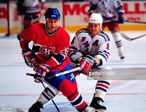 New York Ranger Adam Graves looks to slow down Montreal's Martin Rucinsky during contest at MSG
