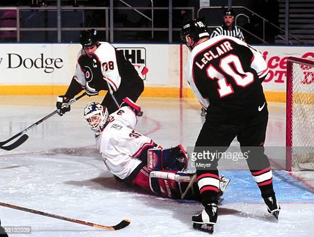 New York Ranger goaltender Mike Richter does wide split to make save on shot by Philadelphia's John LeClair