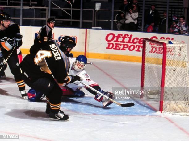 Pittsburgh's Kevin Hatcher puts puck past Ranger goaltender Dan Cloutier