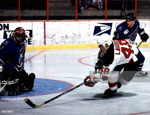 Sasha Lakovic of New Jersey tries to score on Washington's Martin Brochu