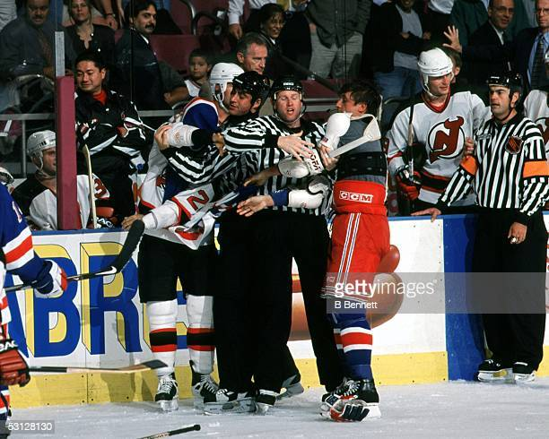 Valeri Kamensky of the Rangers loses his jersey while going at it with Scott Niedermayer of the Devils