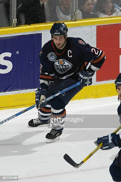 Vancouver Canucks at Edmonton Oilers December 20 2003 And Player Jason Smith