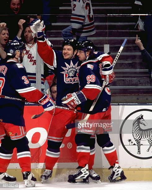 Wayne Gretzky and Esa Tikkanen celebrate with Bruce Driver And Player Wayne Gretzky