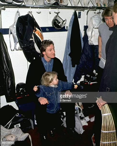 Wayne Gretzky and his son Ty hanging out in the locker room with Jari Kurri And Player Wayne Gretzky