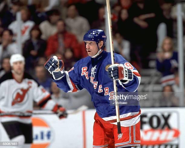 Wayne Gretzky celebrates after scoring his 1000th goal