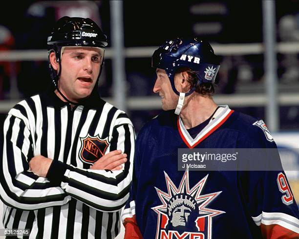 Wayne Gretzky chats with referee And Player Wayne Gretzky