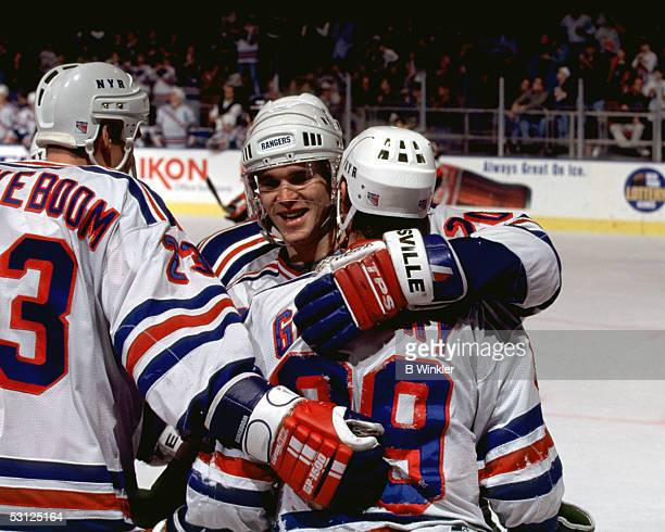 Wayne Gretzky Luc Robitaille and Jeff Beukeboom celebrate And Player Wayne Gretzky