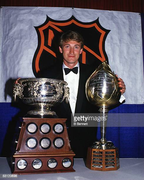 Wayne Gretzky wins the Art Ross and Hart trophies for the 1985 season