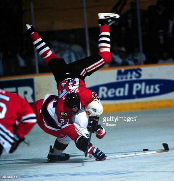 Winnipeg's Keith Tkachuk sends Chicago's Jeremy Roenick flying