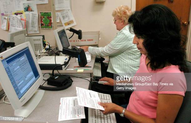 Seasonal clerks Suzie Maney, right, and Nancy Noonan verify signatures on mail-in ballots on May 19 at the Contra Costa County Elections &...