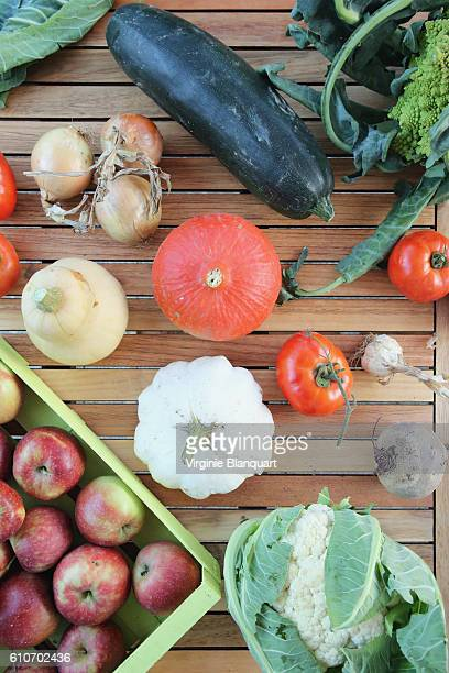 Seasonal fruits and vegetables on a wooden table