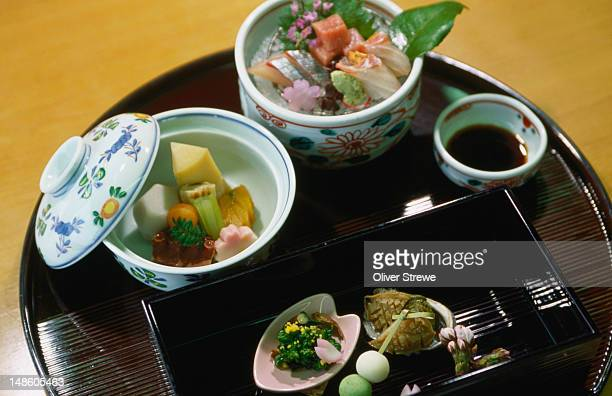 Seasonal kaiseki cuisine from the Hamasaku Restaurant in Kyoto. Kaiseki, usually served at more expensive restaurants, consists of one soup and three side dishes (rice and pickles are included but aren't considered part of the meal).