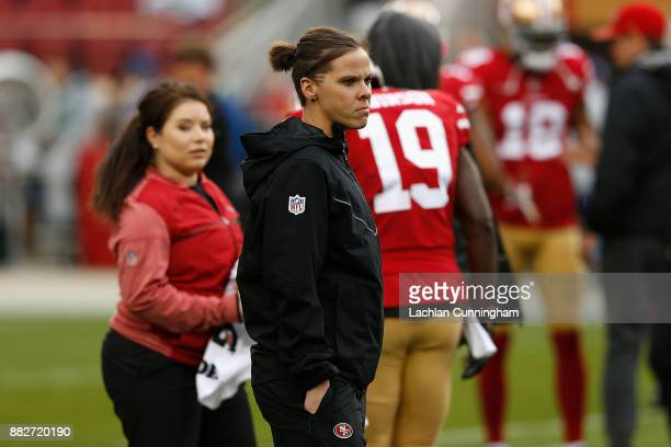 Seasonal Offensive Assistant Coach Katie Sowers looks on during the warm up before the game against the Seattle Seahawks at Levi's Stadium on...