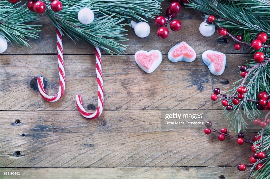 Seasonal Rustic Christmas Border Composed Of Candy Canes And Marshmallow Fir Tree Branches Mistletoe