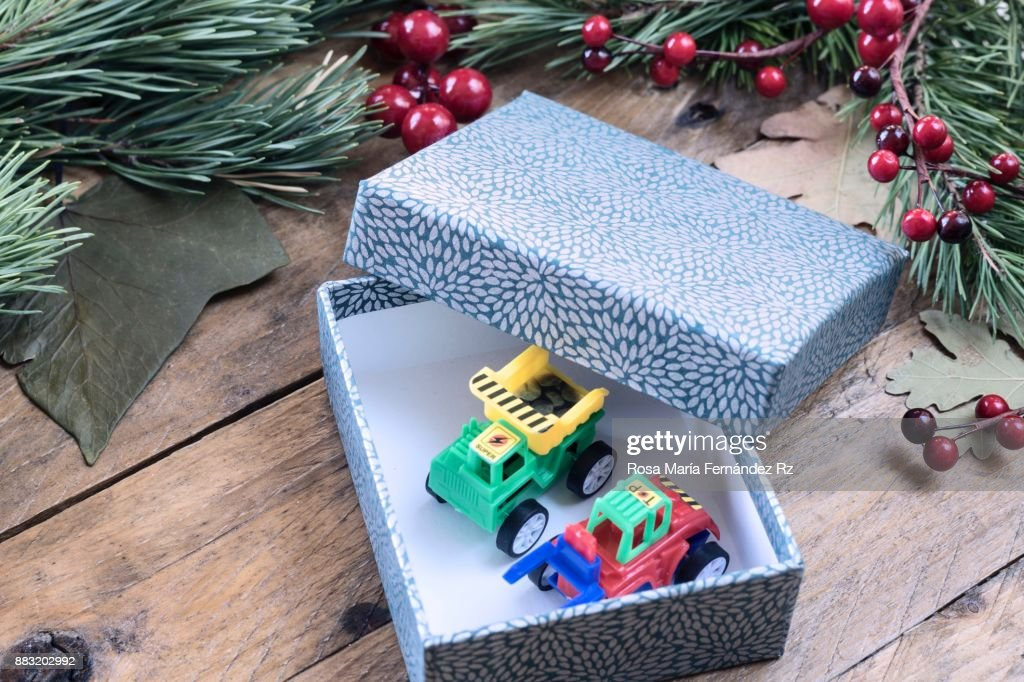 Seasonal Rustic Christmas Border Composed Of Open Gift Box With Toys Inside Fir Tree Branches