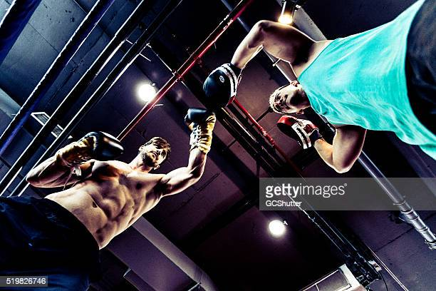 Seasoned Boxers Fighting in a Boxing Ring