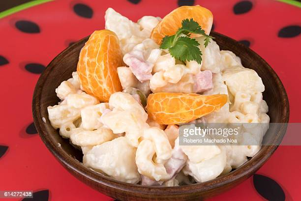 Seasoned pasta salad made at the Cuban style The traditional dish is garnished with mandarin or tangerine The recipe includes mayonnaise and pieces...
