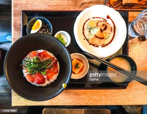 seasoned tuna sashimi donburi and chicken cutlet lunch meal served at washoku restaurant in yokohama - konjac foto e immagini stock