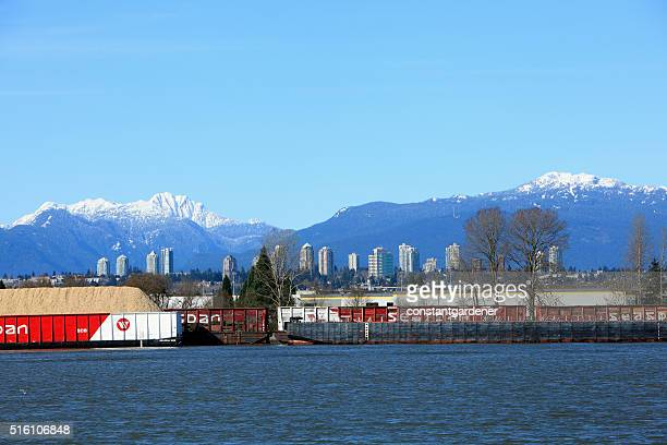 Seaspan On The Fraser To Burnaby High Rises And Mountains