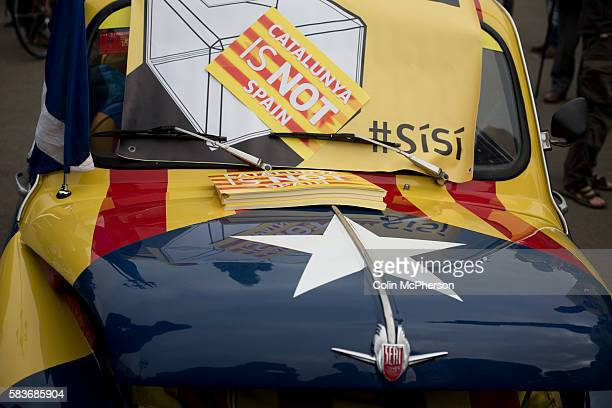 A Seat car decorated with Catalan slogans at a proScottish independence gathering in George Square Glasgow The gathering brought together Yes...