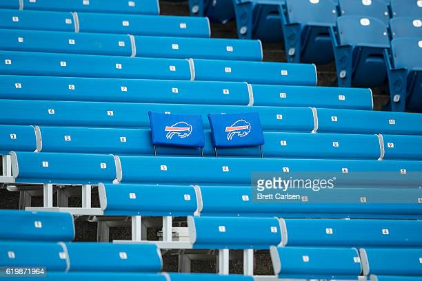 Seat cushions with the Buffalo Bills logo set on empty bleachers before the game between the Buffalo Bills and the New England Patriots on October 30...