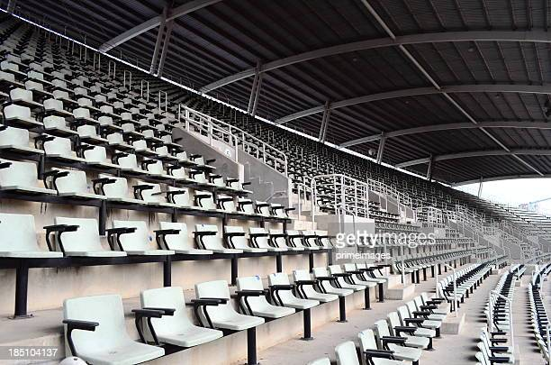 seat in the stadium - empty bleachers stockfoto's en -beelden