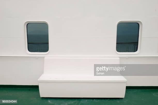 Seat on boat deck between two vessel windows