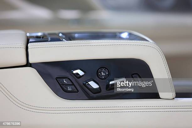 Seat reclining control buttons sit inside a new BMW 7Series X Drive plugin hybrid automobile manufactured by Bayerische Motoren Werke AG in the BMW...