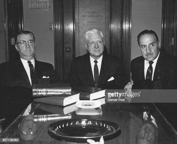 JAN 9 1962 1161962 seated about endof table from left District Judges Gerald E McAuliffe Neil Horan and Credit Denver Post