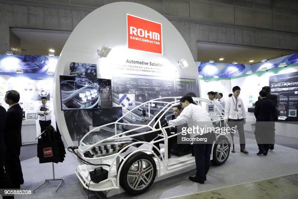 A seated attendee examines an automotive solution system using Rohm Co semiconductor products at the Automotive World 2018 forum in Tokyo Japan on...