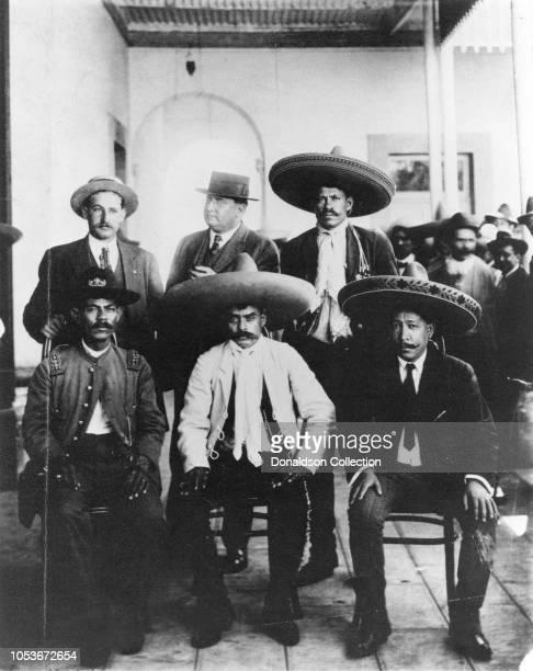 Benjamin Argumedo, Emiliano Zapata and Manuel Palafox. Standing: Ignacio Ocampo, George Carothers and Amador Salazar in Xochimilco after Zapatas...