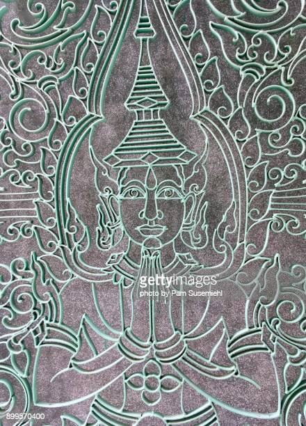 Seated Buddha in a Greeting Pose in Metalwork
