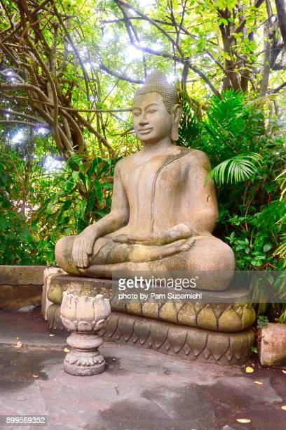 Seated Buddha Statue in Garden, Earth Touching Pose